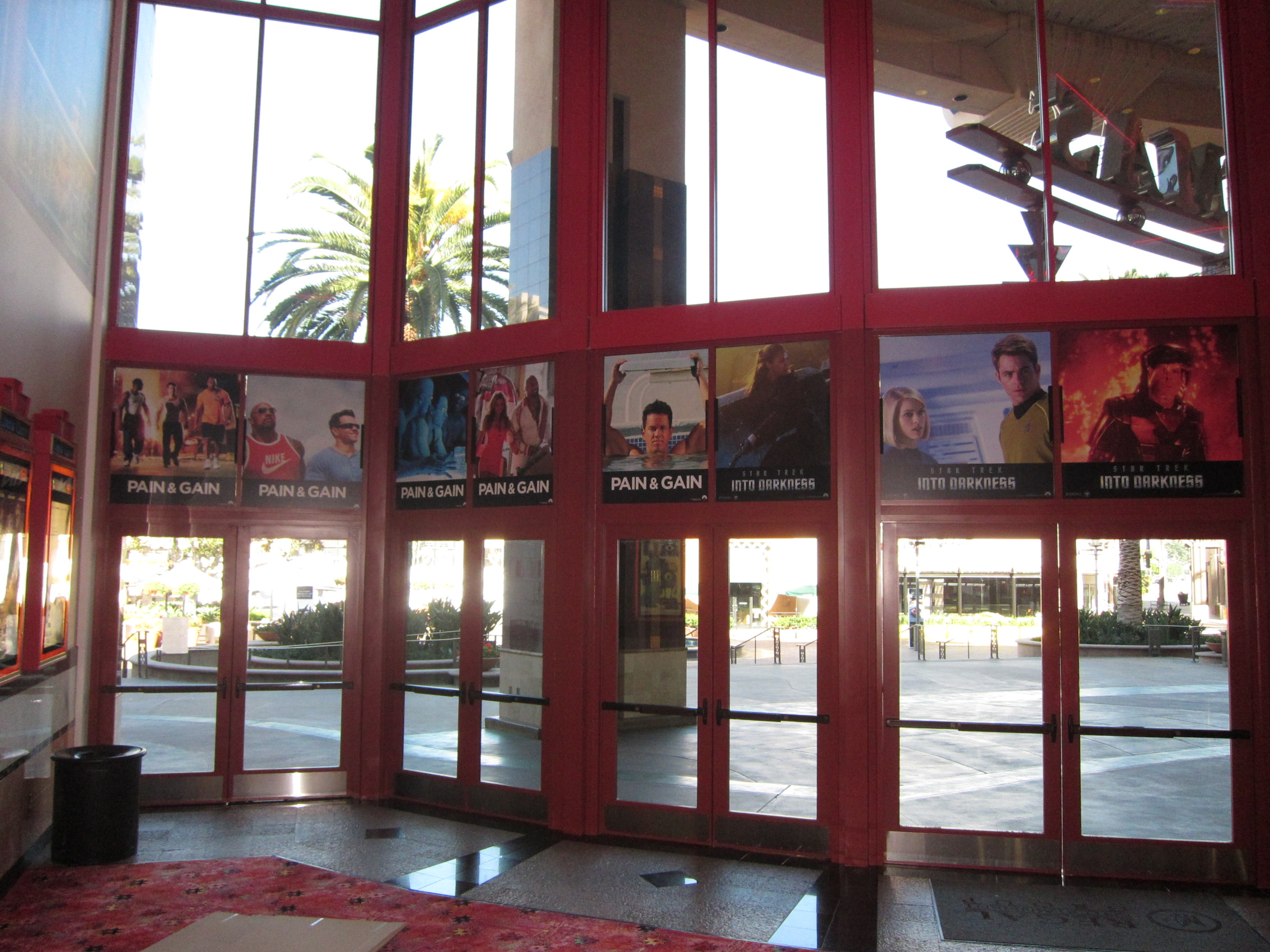 PAIN AND GAIN double sided color photo boards above the doors viewed from inside the theatre lobby.