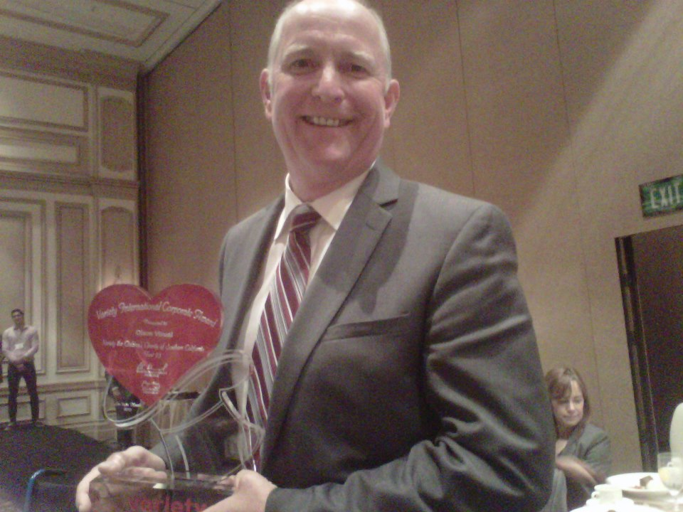 Rick Olson, President of Olson Visual, with a 2013 Variety International Corporate Award.