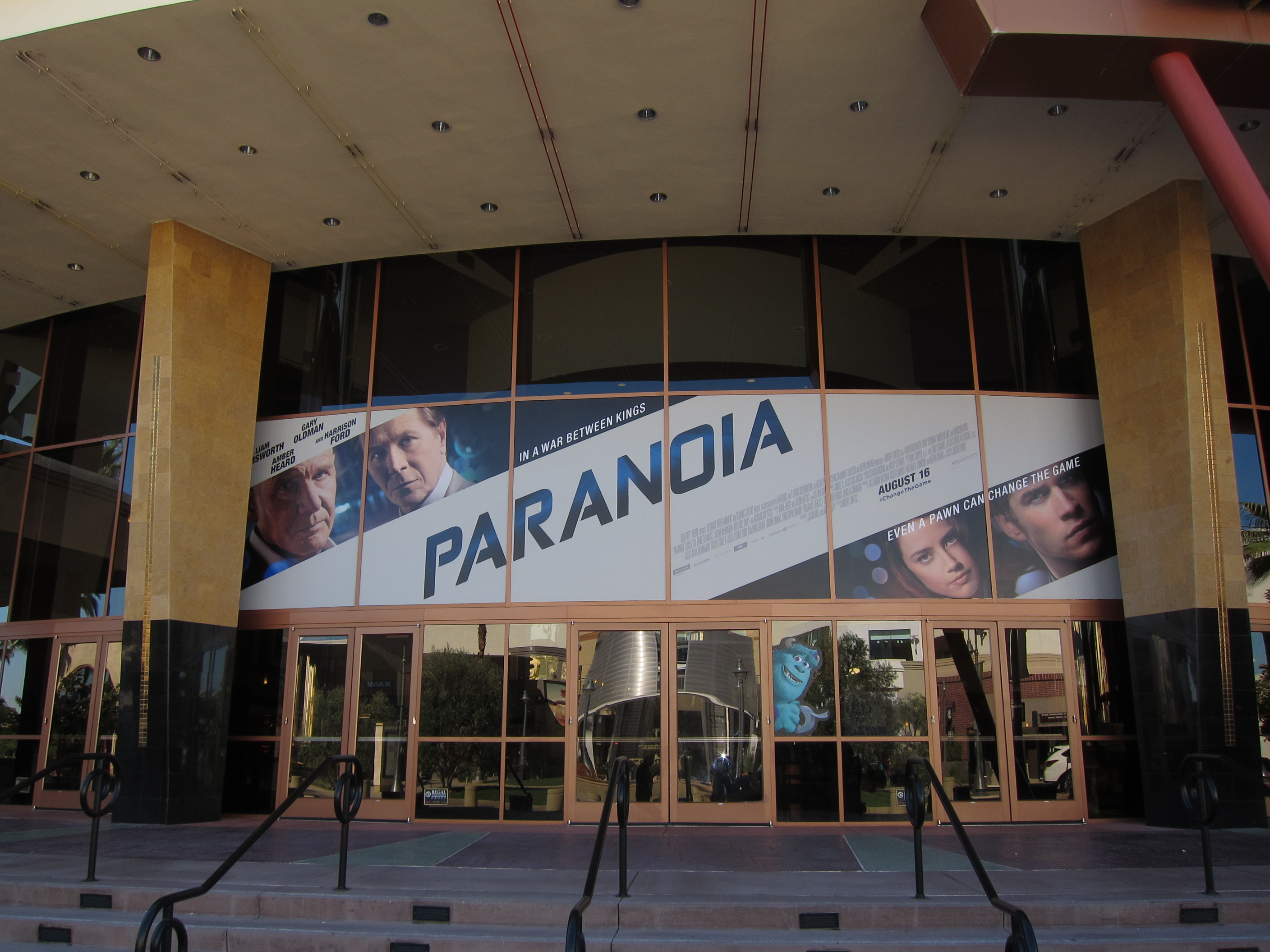 Giant PARANOIA image above the doors of the Regal Edwards Temecula Stadium 15.