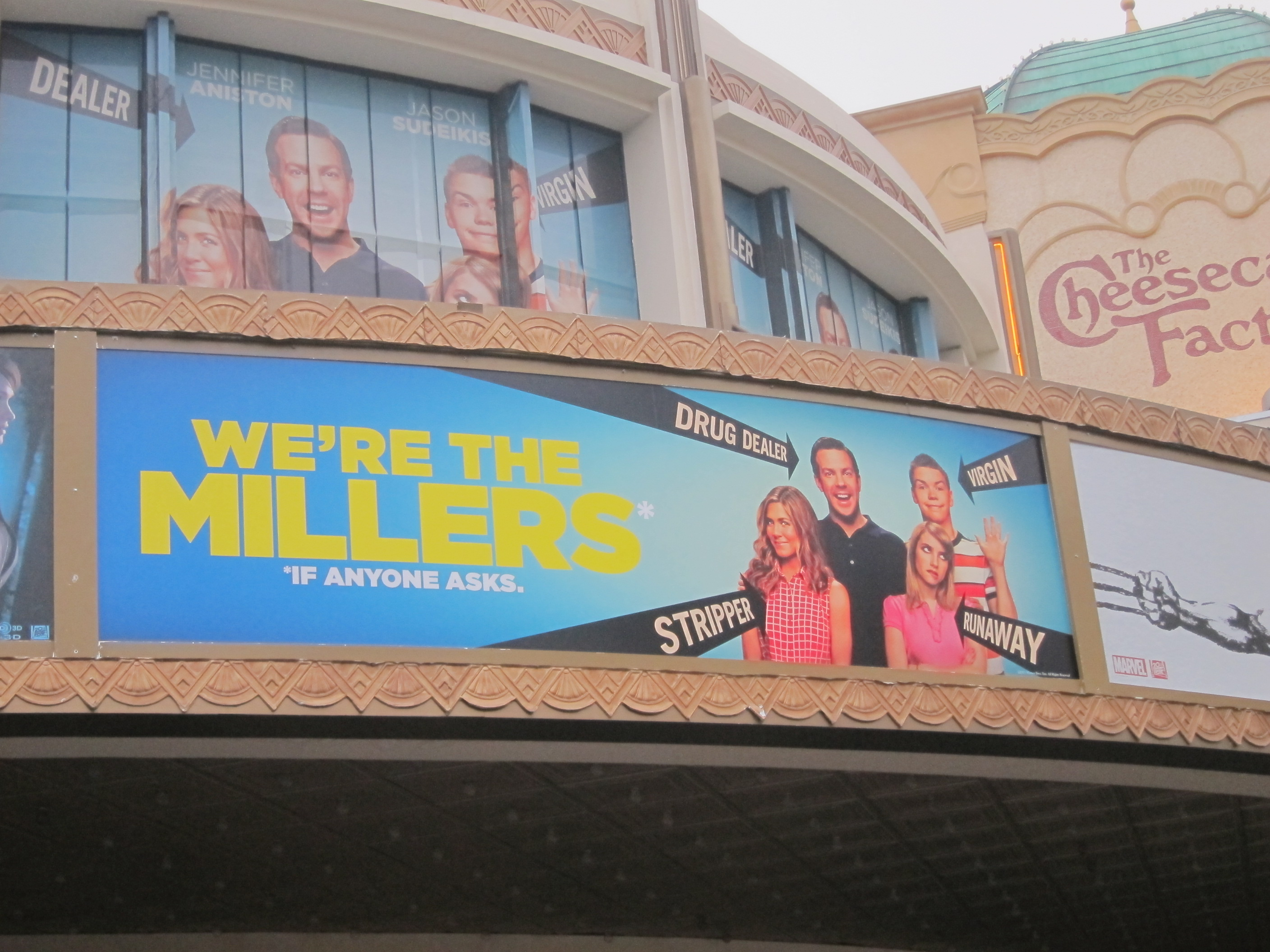 Custom marquee for WE'RE THE MILLERS at The Grove Theatre in Southern California.  Note the special window graphics above the custom marquee.