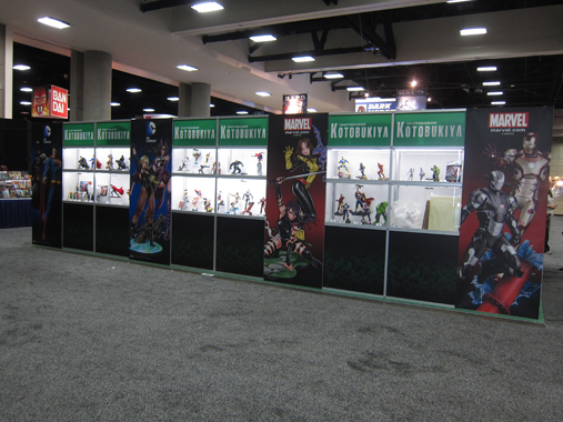 The outsides of the booth (including the back) incorporates printed graphics and acrylic display cases.