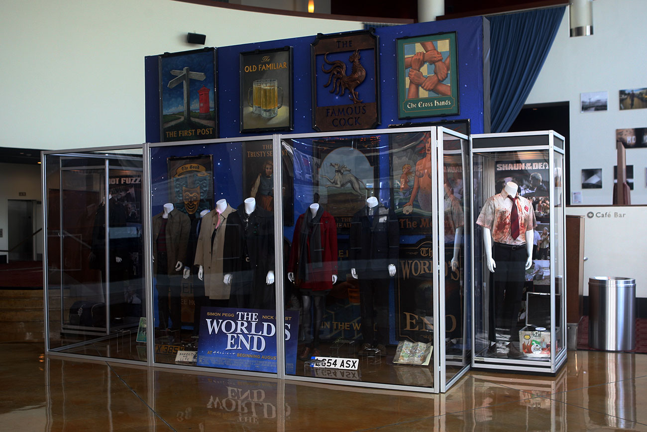 The single case on the right features the costume and props for Simon Pegg from SHAUN OF THE DEAD.