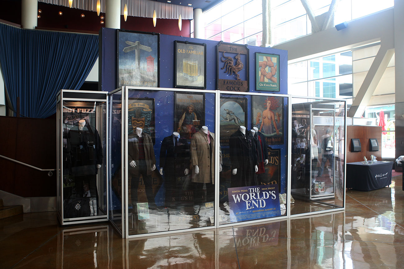 The single case on the left features the original costume and props for Simon Pegg from HOT FUZZ.