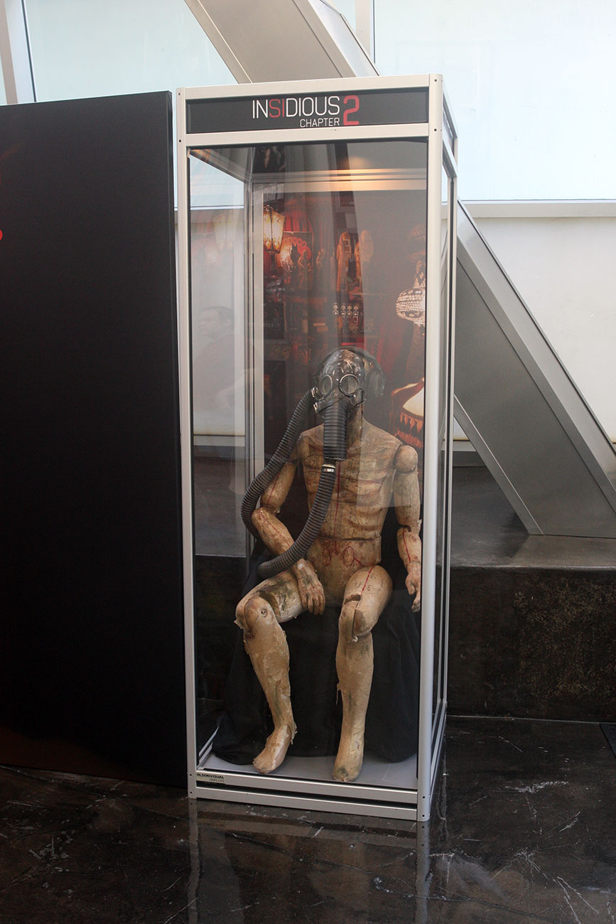 A close look at the gas mask prop strikingly displayed at the ArcLight Hollywood for Film District's INSIDIUS: CHAPTER 2.