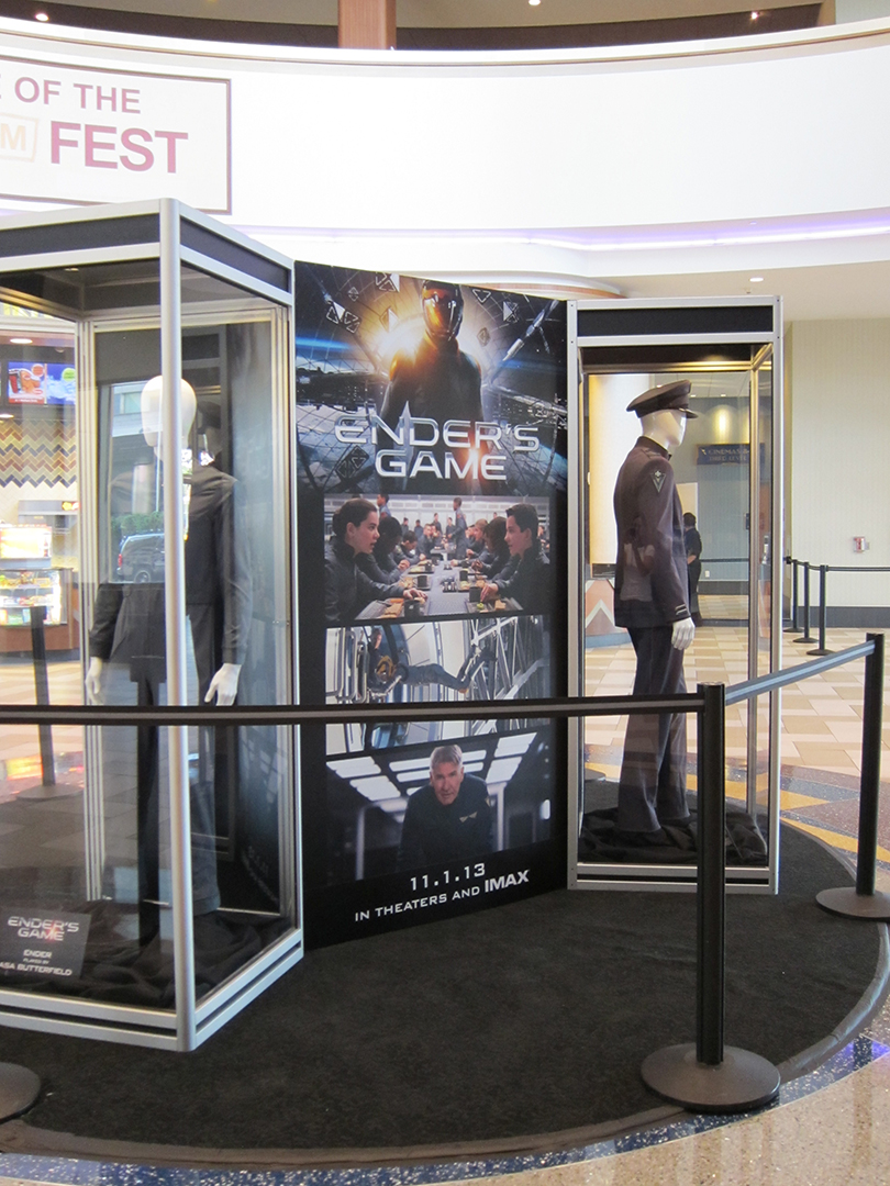 Another angle of the ENDER'S GAME costume exhibit at the Regal LA Live Theatre.