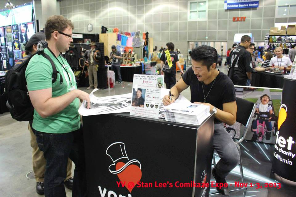 Actor Brian Tee from WOLVERINE signing autographs at the Young Variety of Southern California booth.